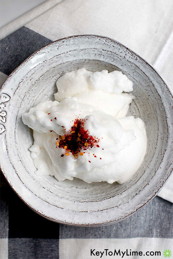 Whipped egg whites in a bowl.