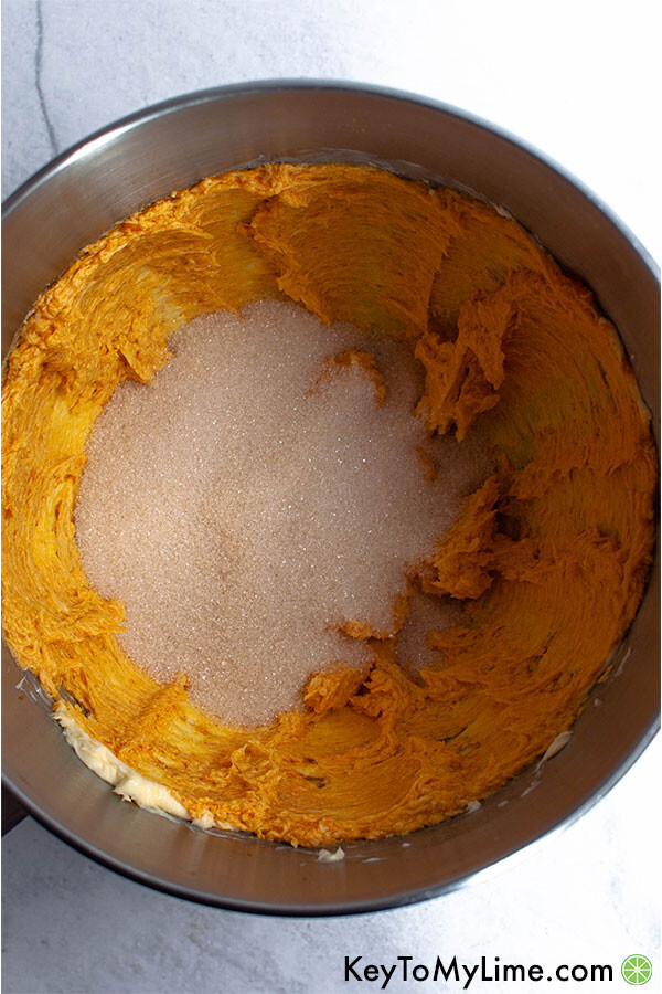 Butter and pumpkin and sugar in a mixing bowl.