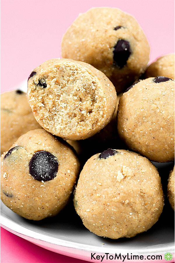 A pile of cookie dough energy balls on a plate.