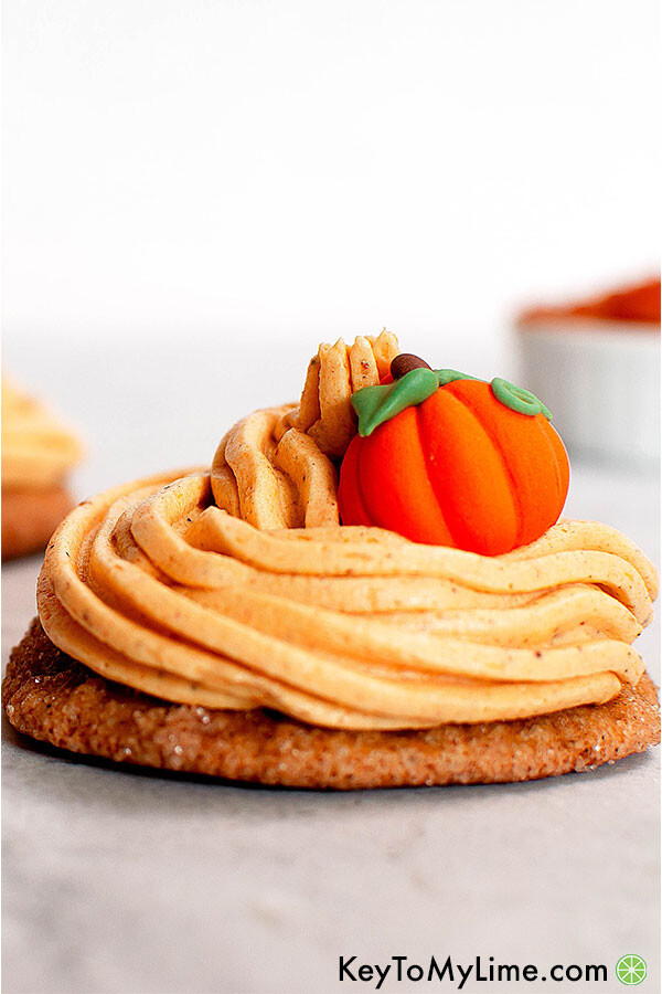 Pumpkin cake cookies with pumpkin buttercream frosting.