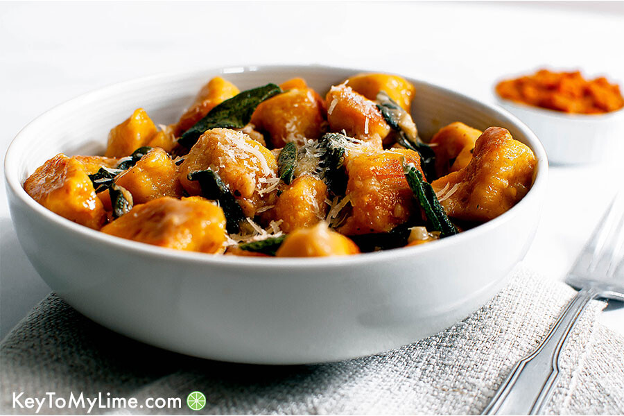 Pumpkin gnocchi with sage butter sauce in a bowl.