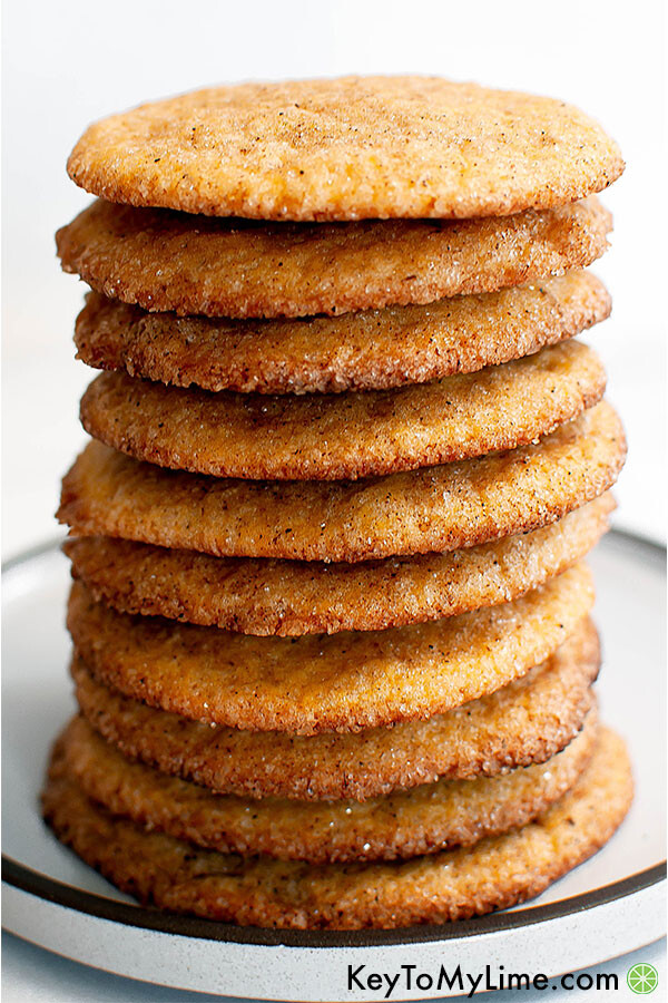 Pumpkin spice snickerdoodle cookies stacked on a plate.