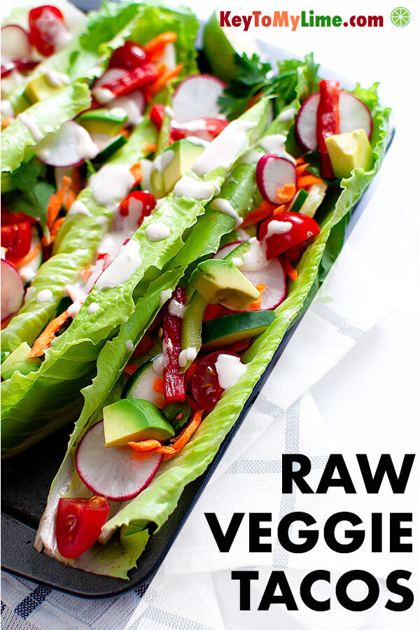 Raw vegetable lettuce boat tacos drizzled with tahini lime sauce.