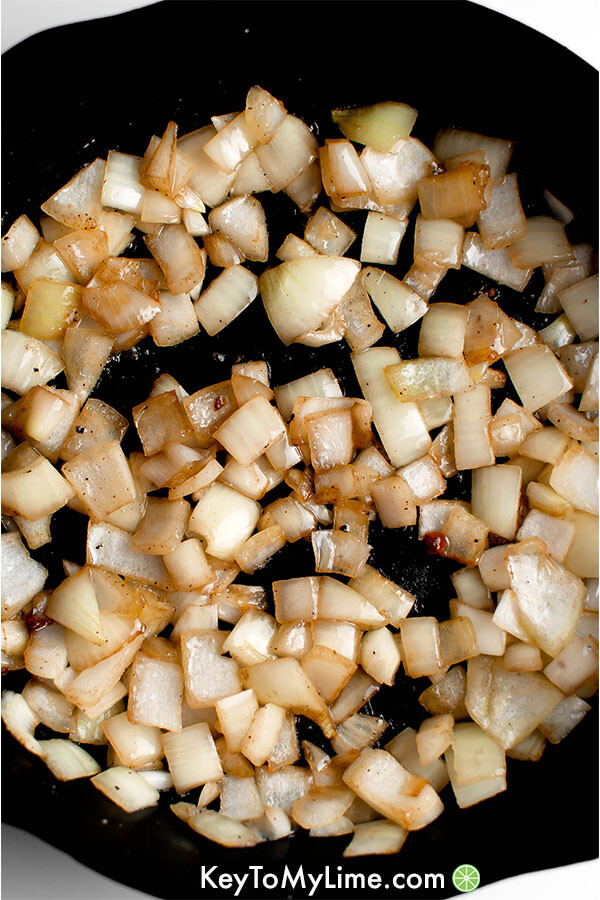 Sauteed onions in a skillet.