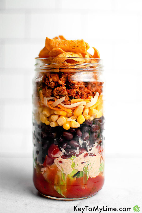 Layered taco salad in a mason jar.