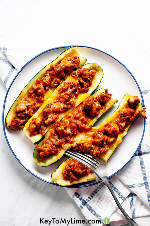 Turkey taco zucchini boats on a plate.