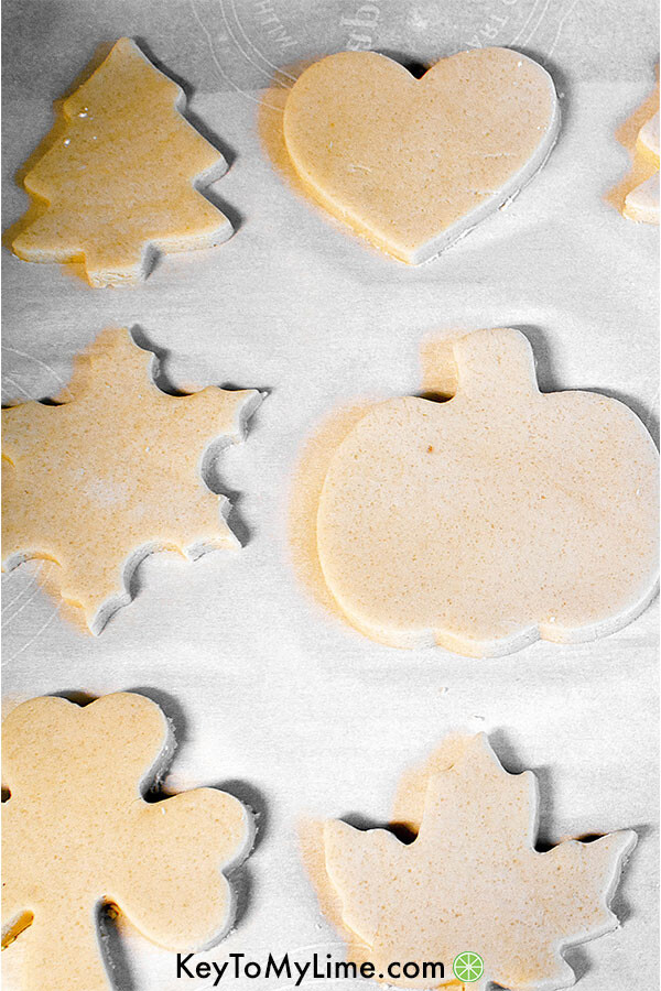 Cut out sugar cookies on a baking sheet ready to go in the oven.