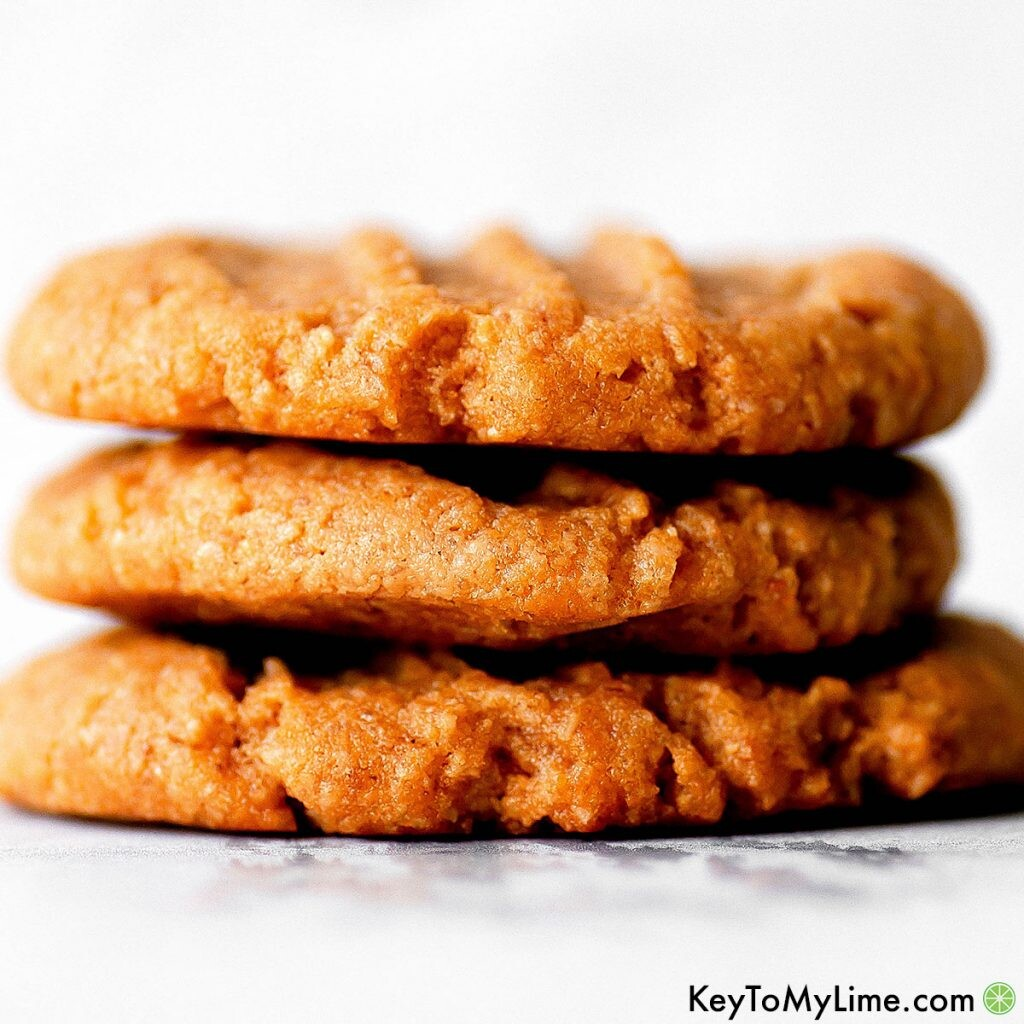 A stack of three vegan peanut butter cookies.