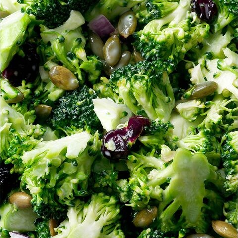A close up image of broccoli cranberry salad.