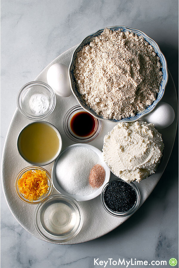 The ingredients for lemon poppy seed pancakes in bowls.