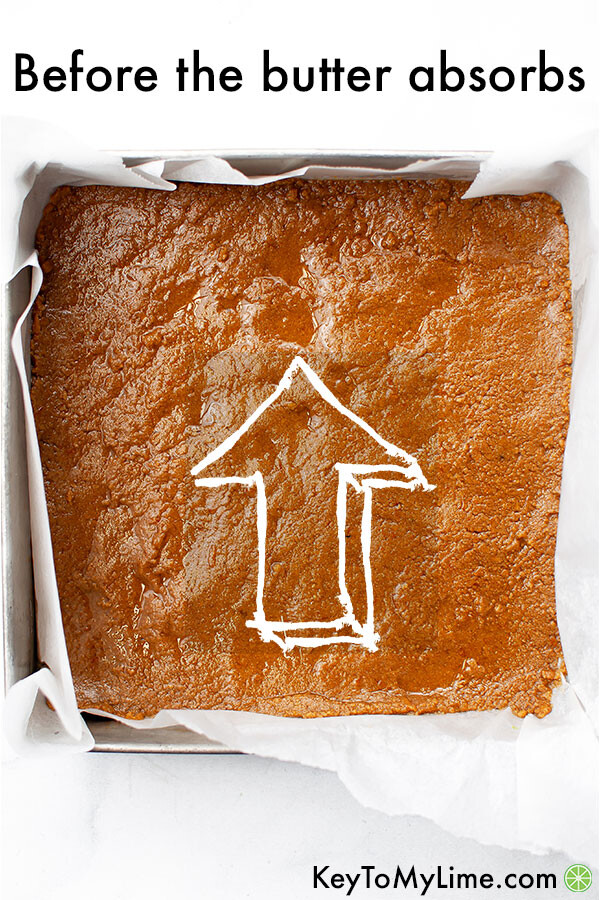 An image showing how gluten free graham cracker crusts tend to have butter pooling before it rests.