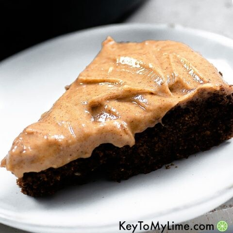 A slice of chocolate cake with vegan almond butter frosting.