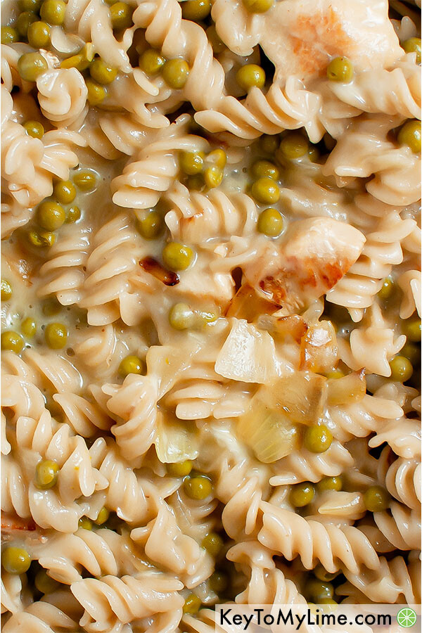 A close up image of quick and easy pasta with peas.