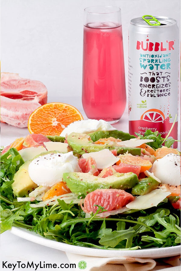 Avocado Grapefruit Salad on a platter with a can of BUBBL'R sparkling water in the background.
