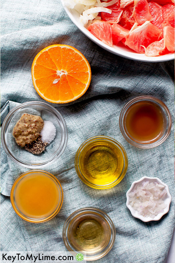 An overhead image of the ingredients for citrus vinaigrette on a blue napkin.