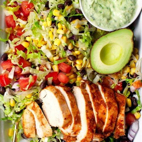 Southwest chicken salad in a platter with the salad ingredients mixed together.