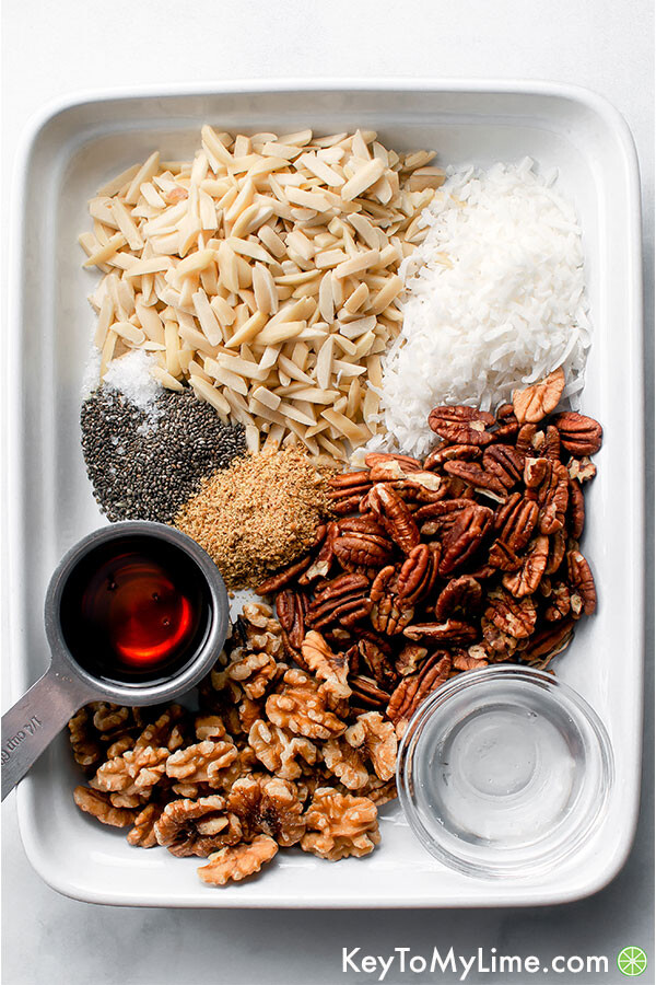 A process image showing the ingredients for grain free granola in a white platter.