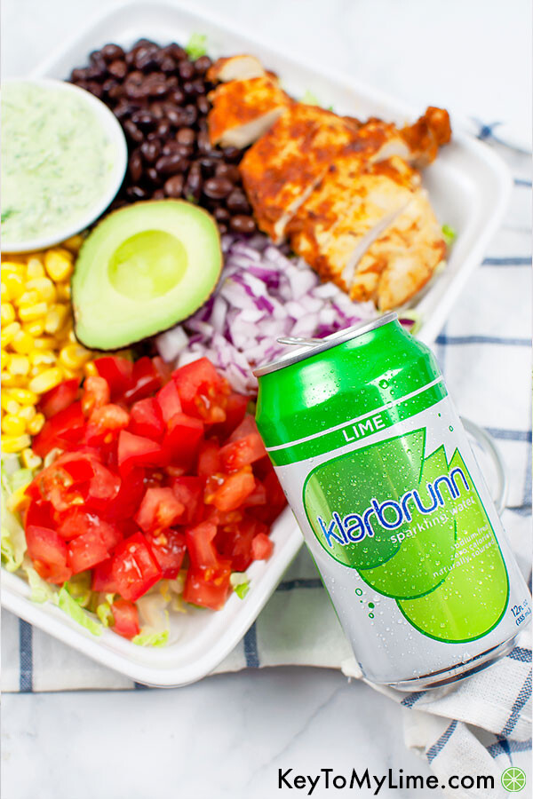 An image of southwest chicken salad in the background and a can of lime Klarbrunn sparkling water in the foreground.