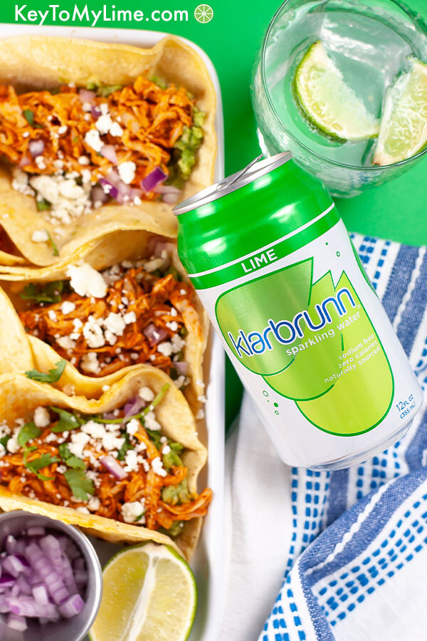 Tacos in a platter with a can of Klarbrunn sparkling water overlapping the platter.