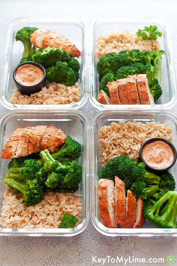 An angled image of the chicken and rice meal prep displaying the highlights on the sauce.