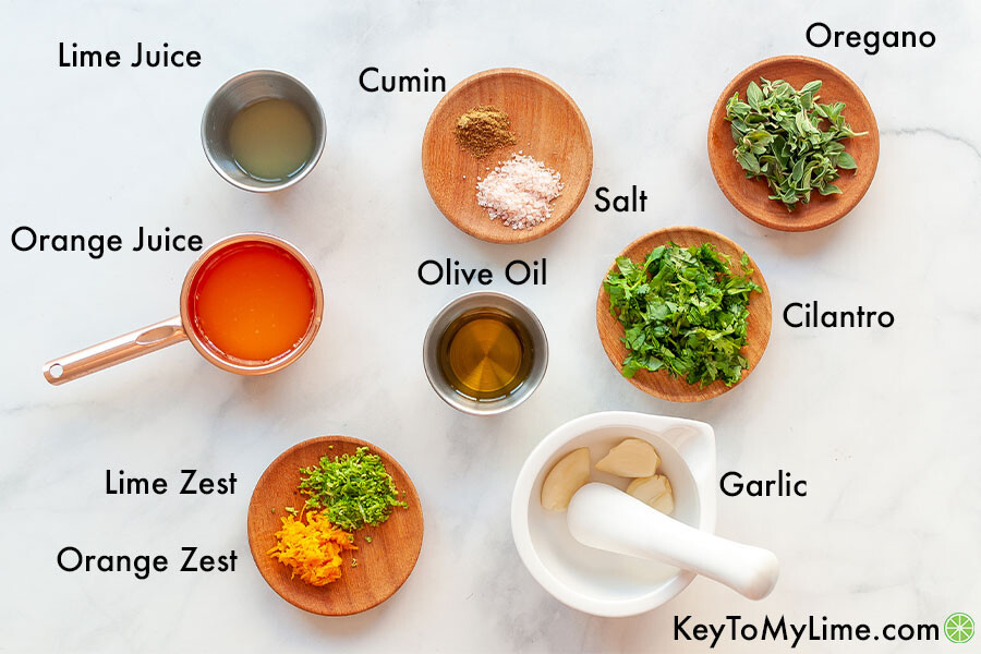 An image of mojo sauce ingredients in small containers with the ingredients labeled.