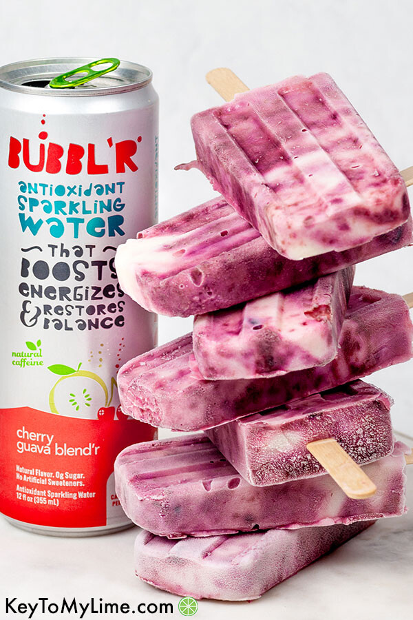 A stack of yogurt popsicles next to a can of BUBBL'R.