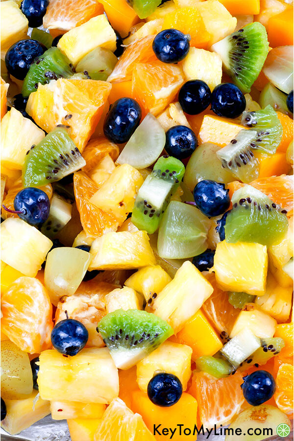 A close up image of pineapple fruit salad mixed together.