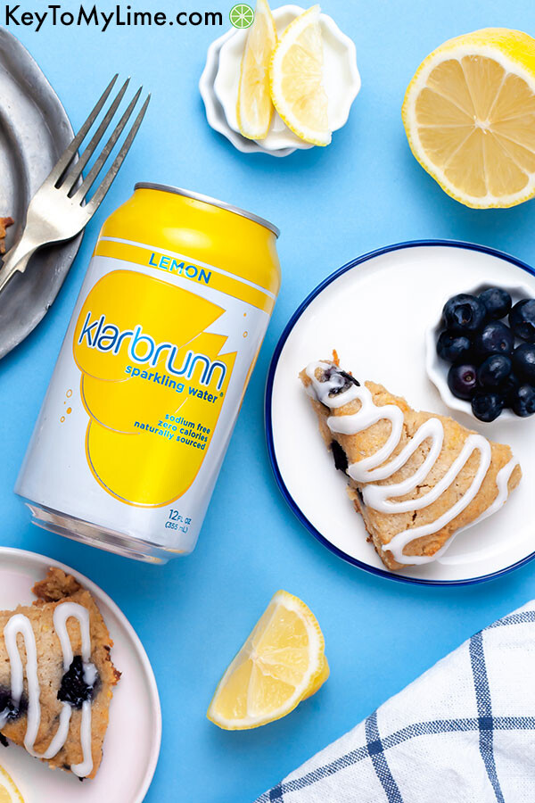 Keto scones on a blue background with a can of lemon Klarbrunn sparkling water.