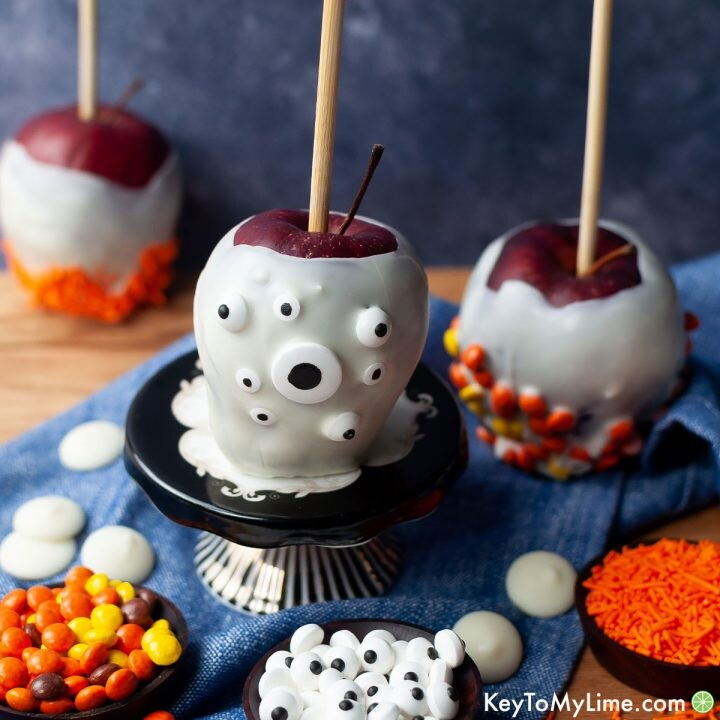 Halloween apples dipped in white chocolate and rolled in candy.