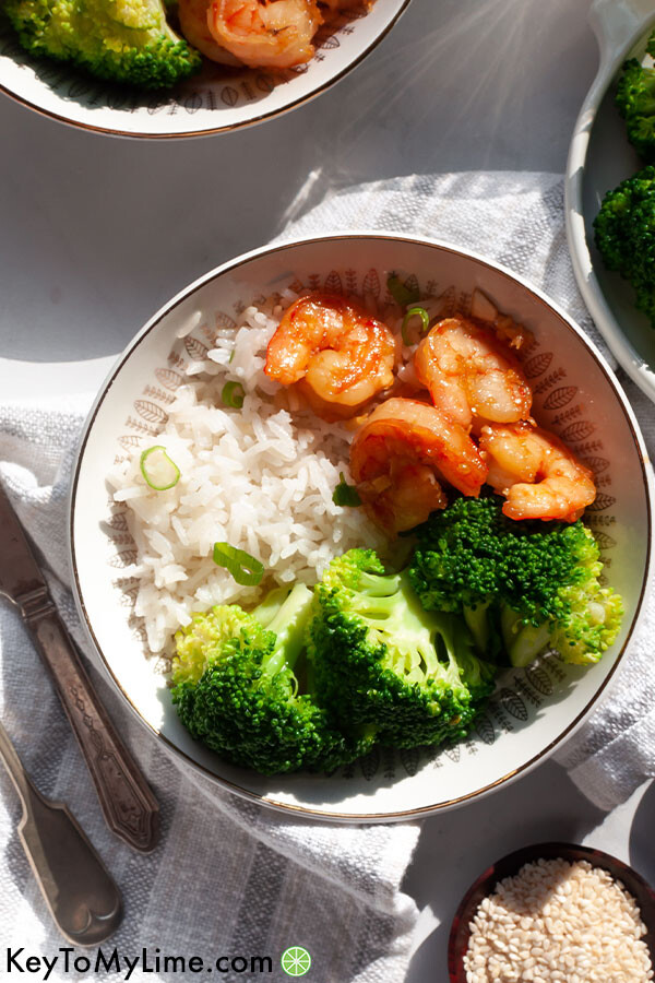 Honey garlic shrimp in a bowl with natural afternoon light shining on it.