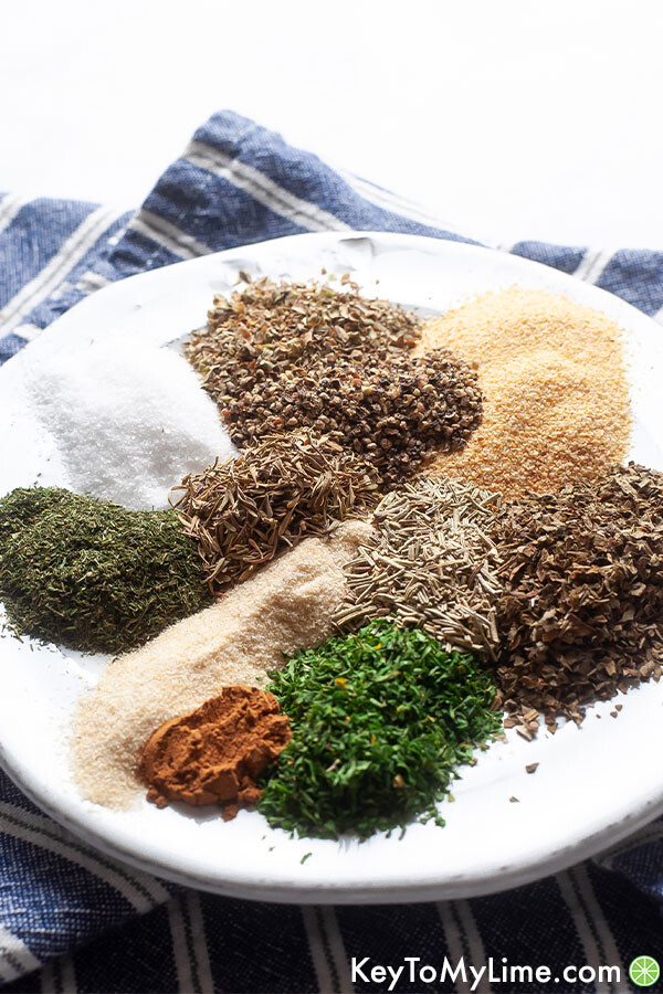 A side image of Greek seasoning ingredients on a small white plate.