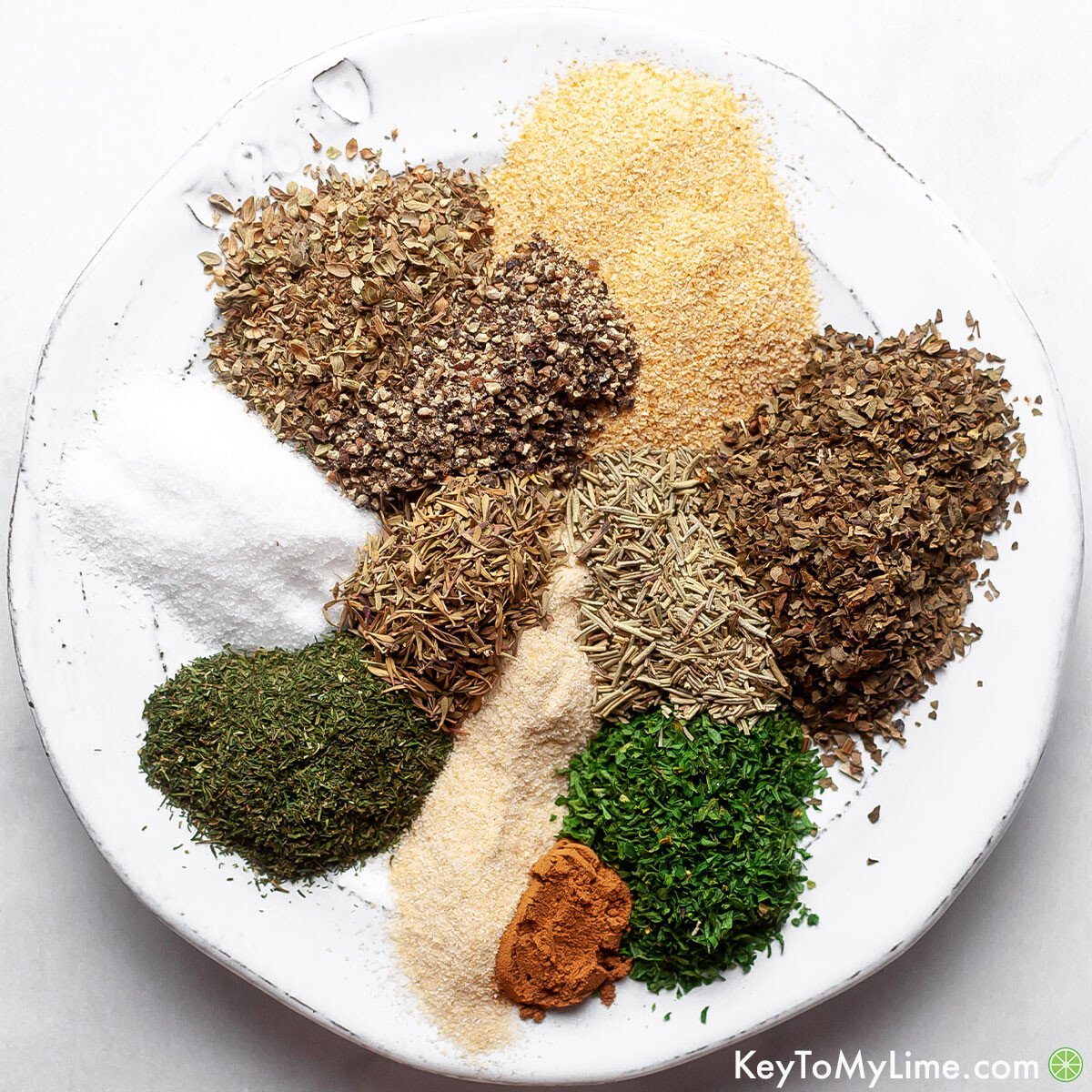 Mediterranean seasoning ingredients on a white plate.