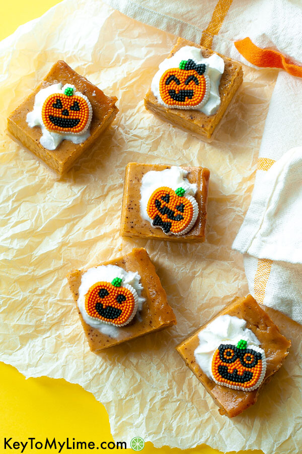 An overhead image of pumpkin pie bars on a yellow background.