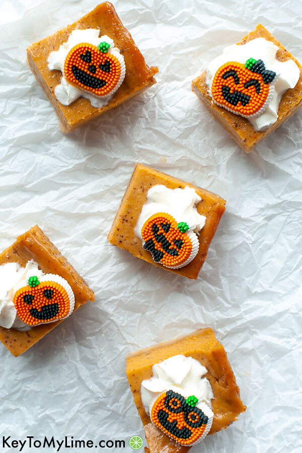 Pumpkin bars scattered on a piece of crumpled parchment paper.