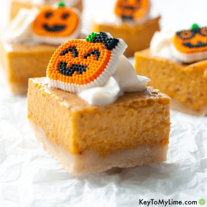 A side image of pumpkin pie bars on a white background.