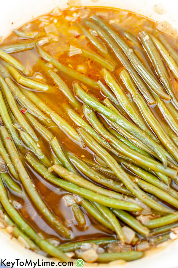 Southern green beans cooking in a large pot.