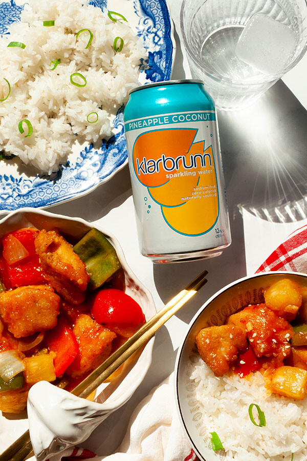 Sweet and sour chicken with a can of Klarbrunn sparkling water.