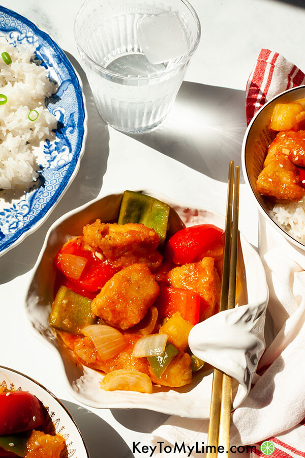Sweet and sour chicken on a small white plate.