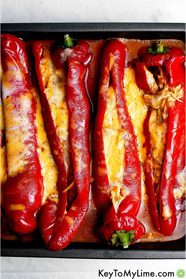 Chicken stuffed peppers in a pan.
