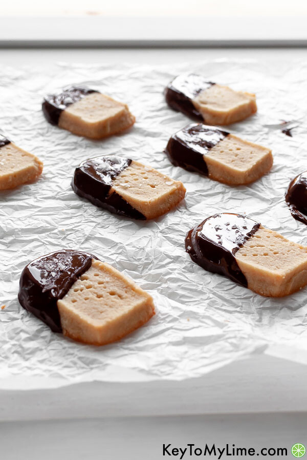 Chocolate dipped keto shortbread with light glistening off the chocolate.