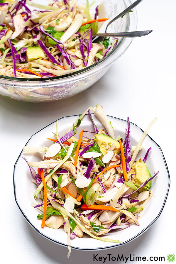 Two bowls on a white background with Chinese chicken salad.