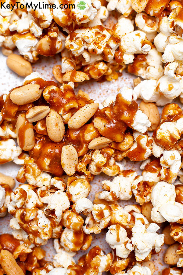 A close up of a caramel, popcorn, and peanut cluster.