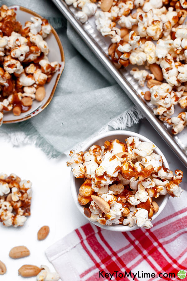 Carmel popcorn in various bowls on green and red napkins.