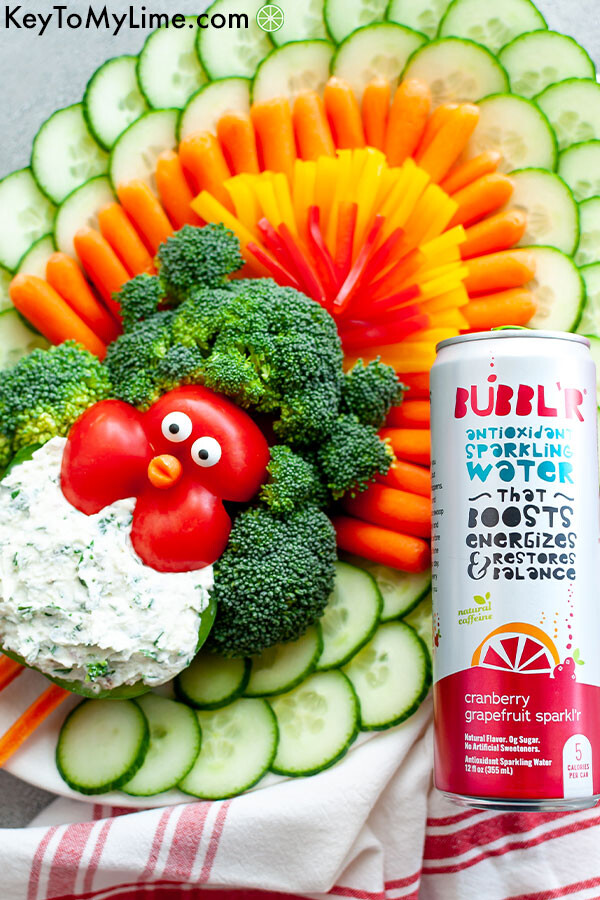 A turkey vegetable platter with a can of antioxidant sparkling water.