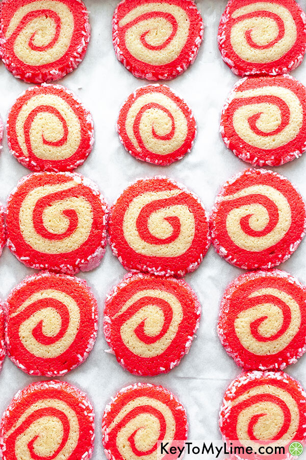 Christmas swirl cookies on a baking sheet fresh out of the oven.
