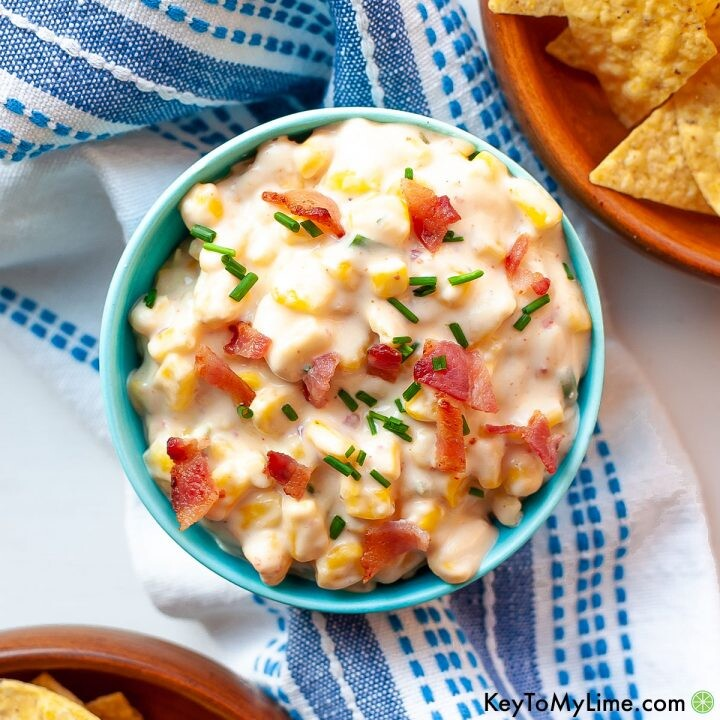 Slow cooker jalapeno corn dip in a small turquoise bowl.