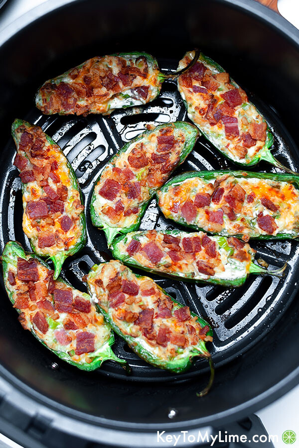 Jalapeno poppers in air fryer after cooking.