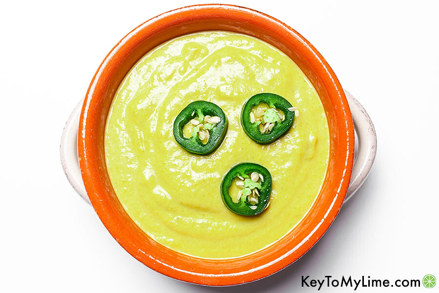 Jalapeno sauce in a bowl on a white background.
