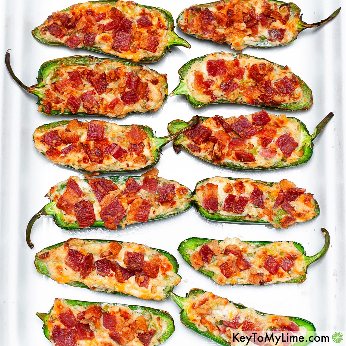 Air fryer keto jalapeno poppers on a white platter,