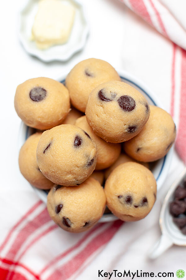 Keto chocolate chip cookie dough balls in a small bowl.